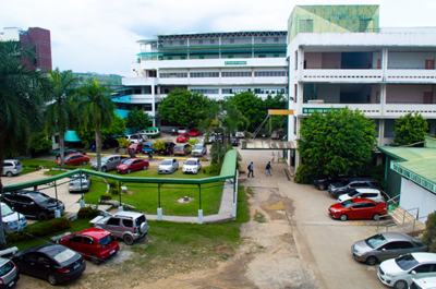 Overlook of UV Gullas multi building campus with car parking