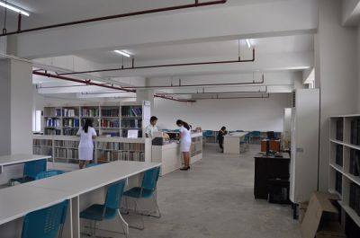 Students accessing books of Multi racked Large Library.